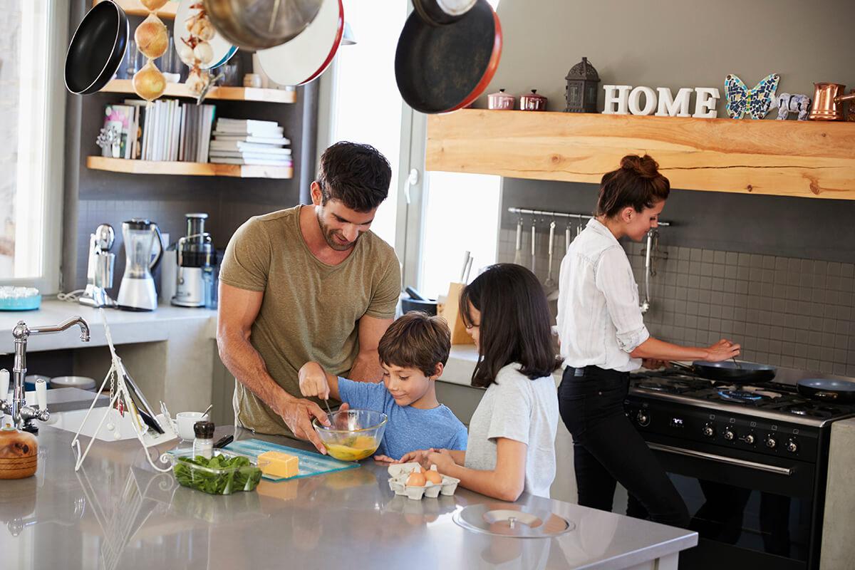 family in kitchen making morning breakfast